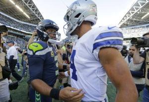 Seattle Seahawks quarterback Russell Wilson, left, greets Dallas Cowboys quarterback Dak Prescott, r