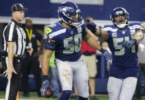 Seattle Seahawks' K.J. Wright (50) and Bobby Wagner (54) celebrate an interception against Dallas Co